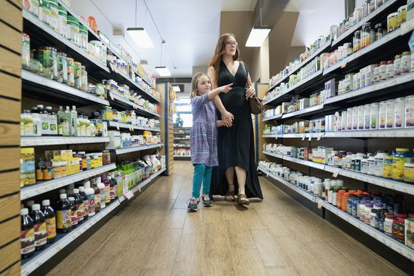 Mother and daughter browsing in nutrition store