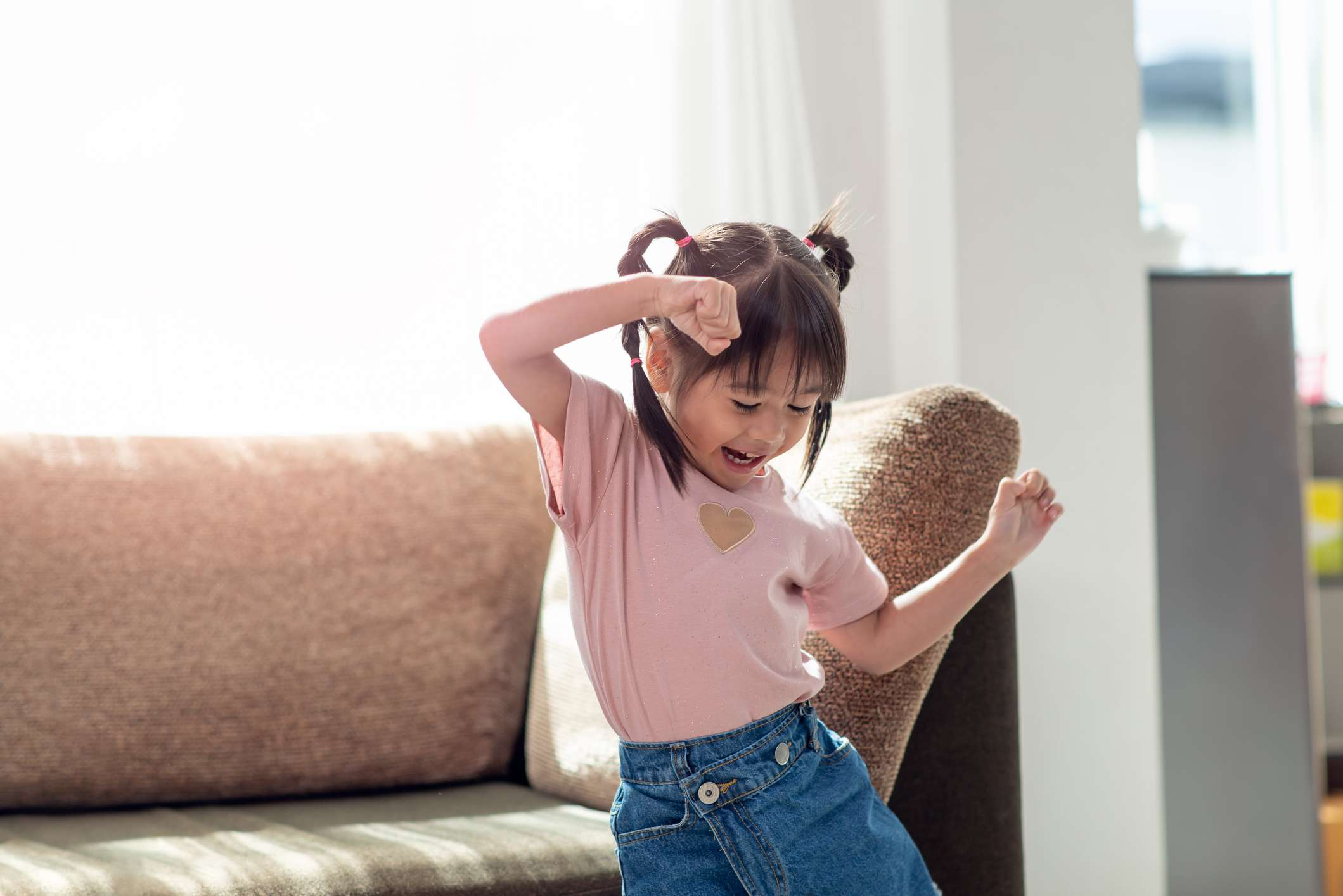 Young child having fun and dancing
