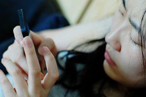 Upset teen on smartphone