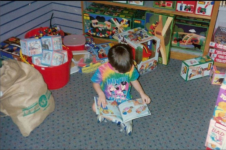 My son reading a book in a museum gift shop