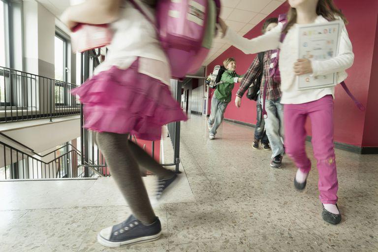 School students running in corridor, Bavaria, Germany