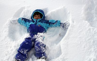 Kid is snowsuit