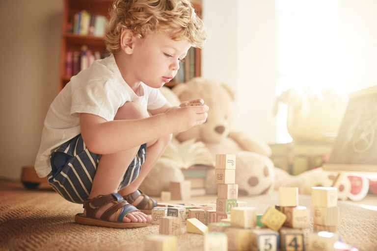Child playing with and stacking blocks
