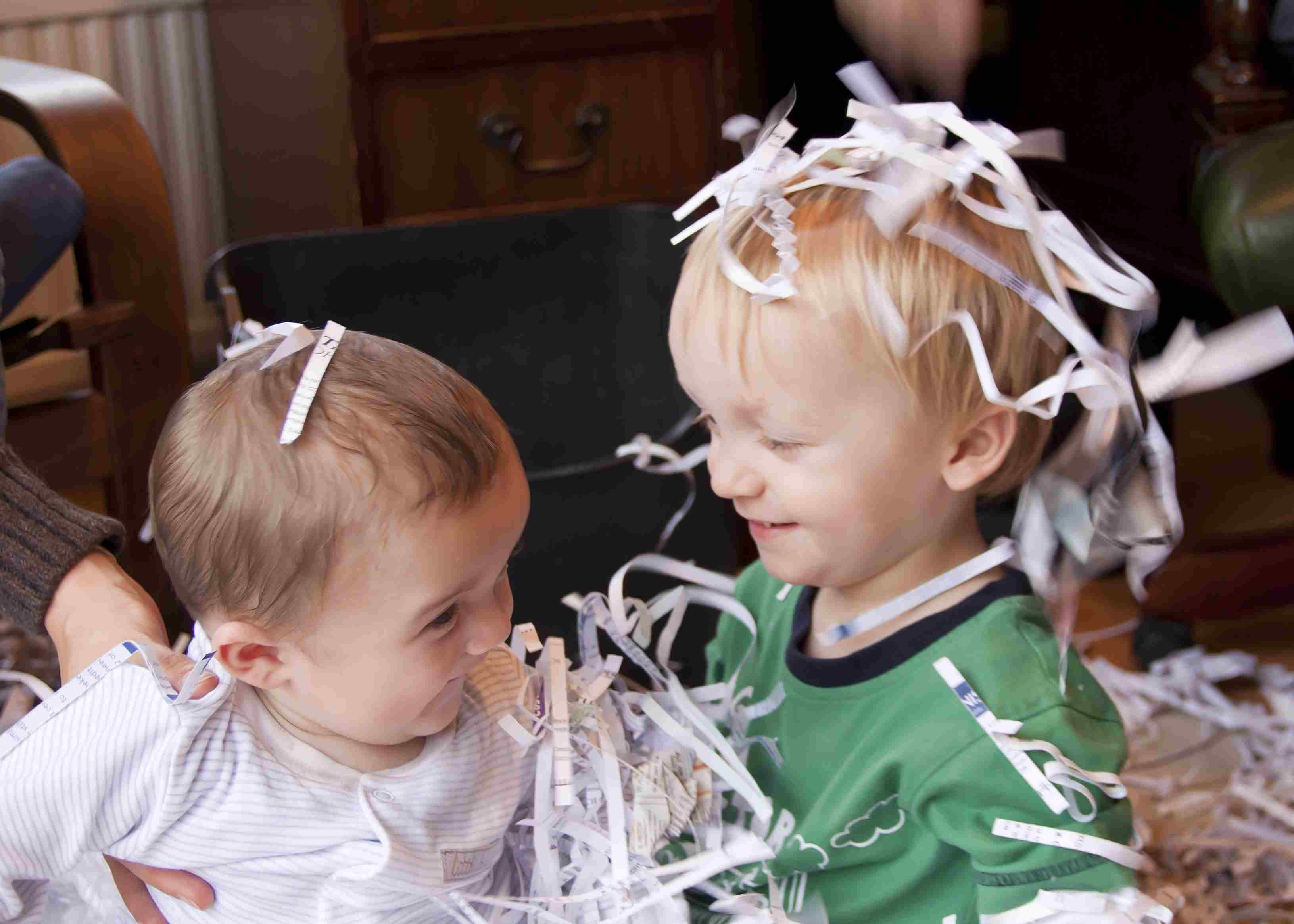 Boys playing with shredded paper