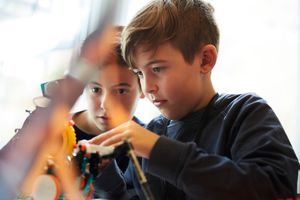 Kids working with robot in an in-store class