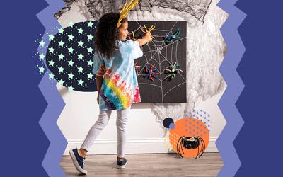 Girl doing spider crafts