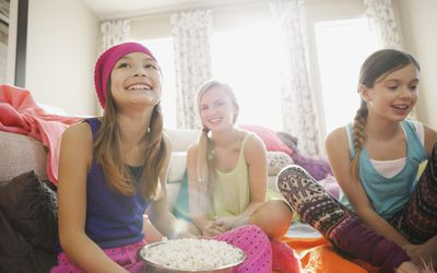 Girls hanging out at slumber party