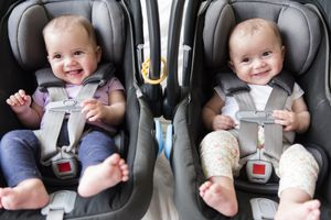 Caucasian twin baby girls in car seats