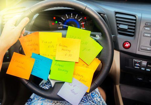 Post It notes on steering wheel