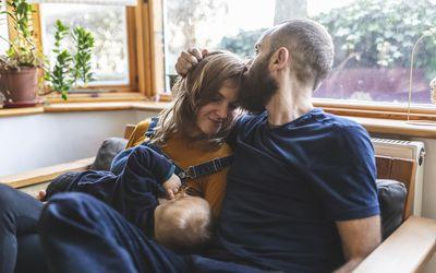 Woman on the sofa breastfeeding her baby