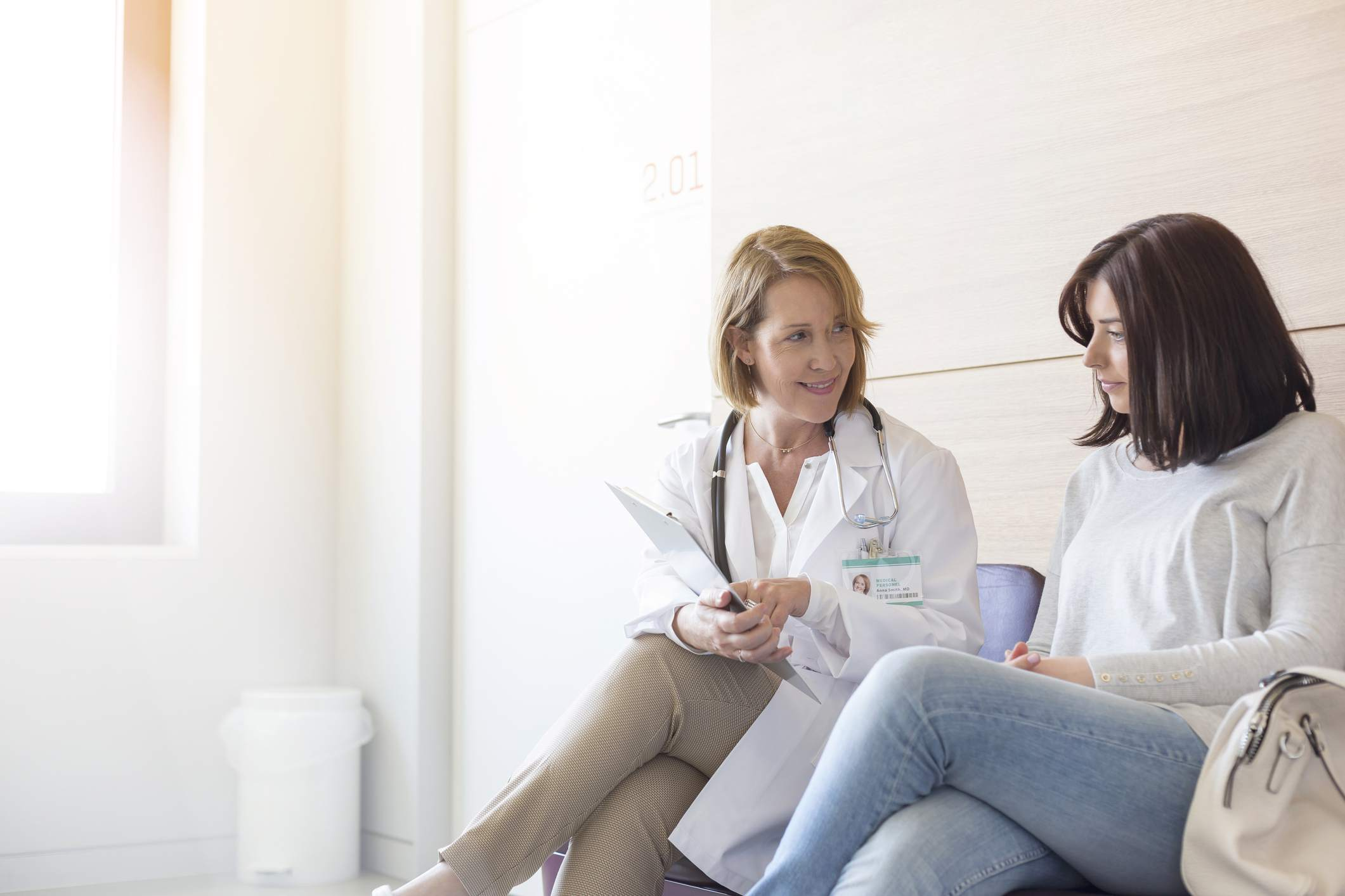 Doctor and patient reviewing medical file
