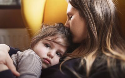 Little girl in mother's arms
