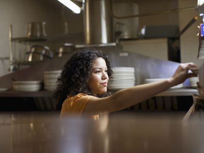 waitress in mexican restaurant