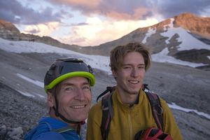 Father and son mountaineers selfie, early alpenglow