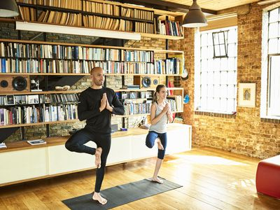 Father and daughter practicing yoga