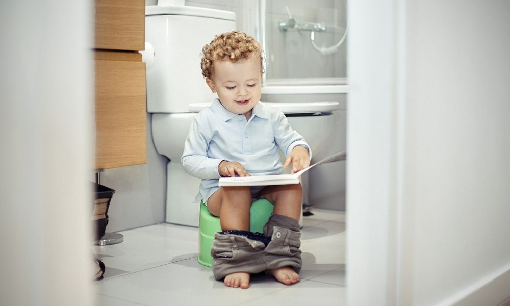 Child sitting on the toilet