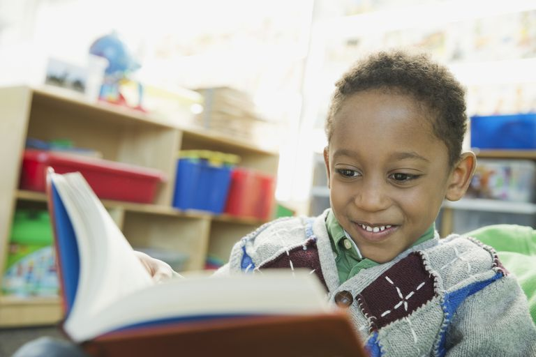 Boy reading in elementary school classroom