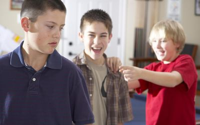 Boy (11-12) being picked on by bullies