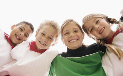 Sports team bonding - kids smiling