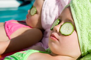 girls with cucumber slices on eyes at spa - spoiled kids