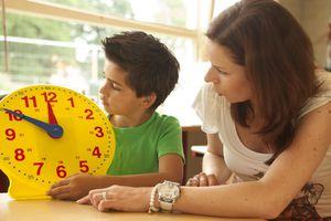 Little boy learning the clock