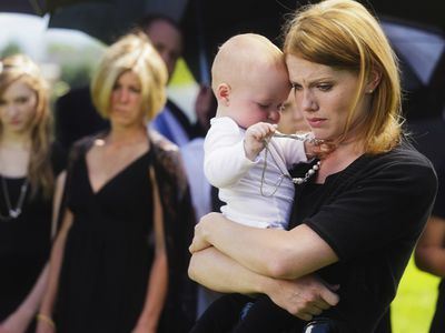 Mother and baby at funeral