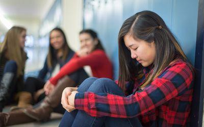 Girl getting bullied in high school hallway