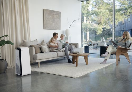 Family spending time in their home, with their Blueair Air Purifier in the corner