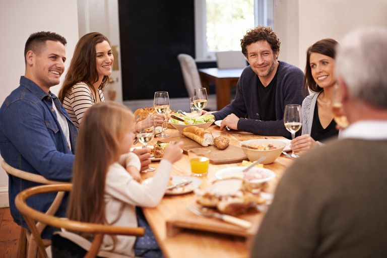 Shot of a family sitting down to dinner together