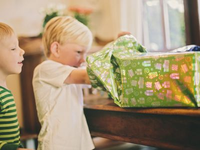 5 year old boy opening a present