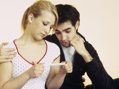 Young couple looking at a negative pregnancy test