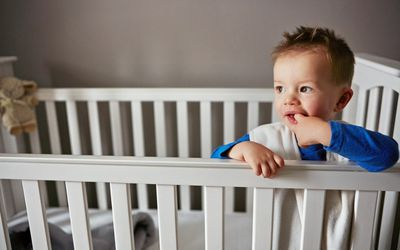 toddler awake in crib