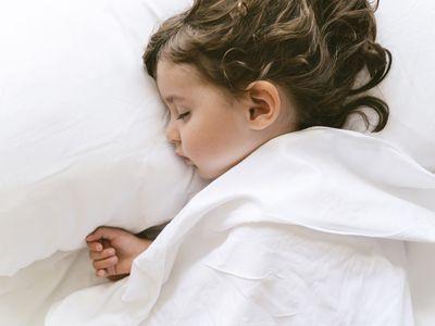 Toddler sleeping on pillow