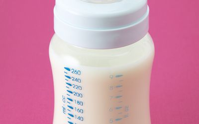 Bottle of milk with pink background