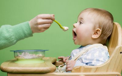 Baby Eating Baby Food With a Spoon