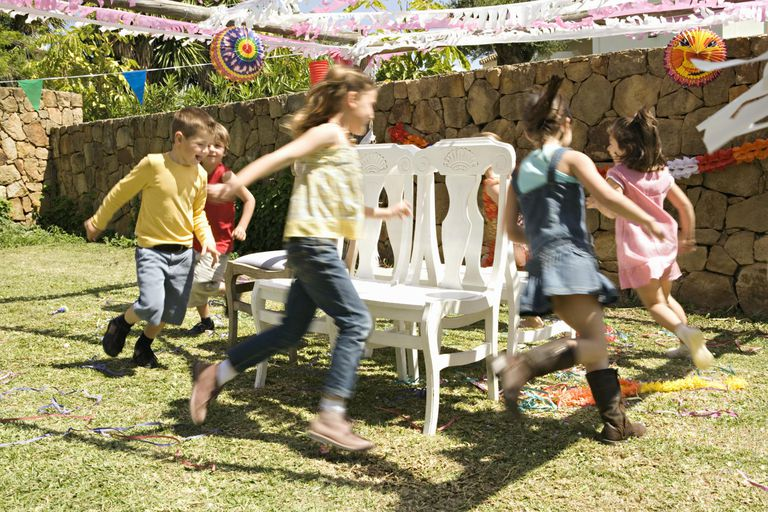 Active birthday party - kids playing musical chairs
