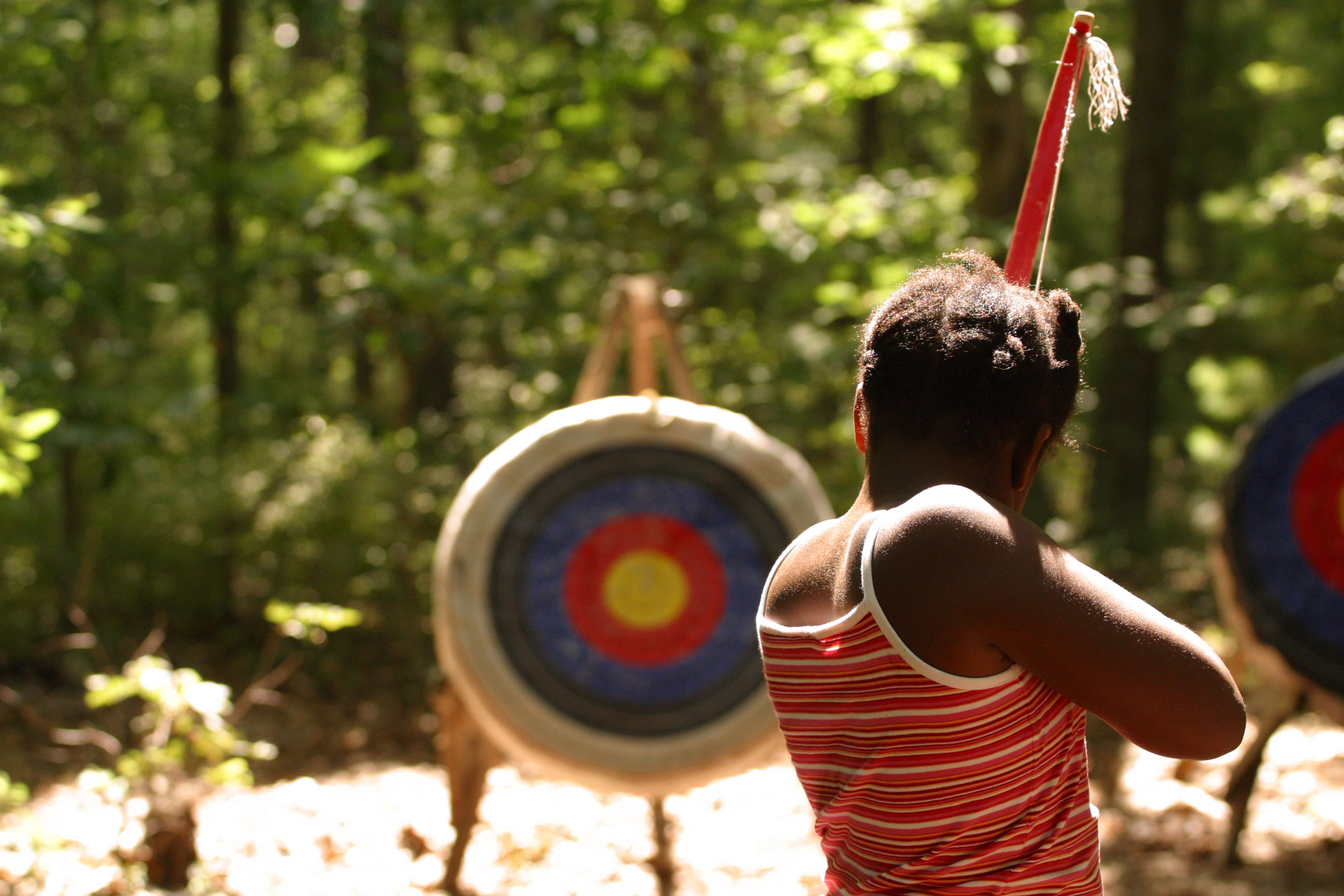 girl shooting bow and and arrows