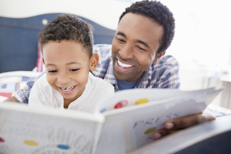 Man reading with his son