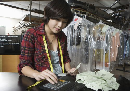 woman working at dry cleaners