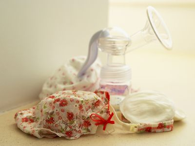 Nursing bra with breast pads and a breast pump
