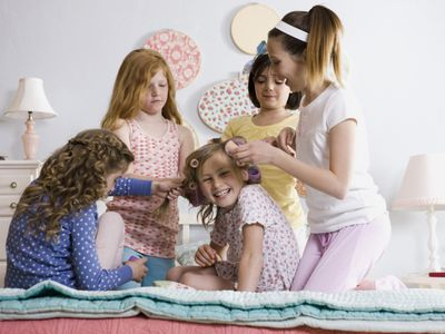 Five girls on a bed