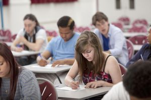 Students taking notes in a classroom