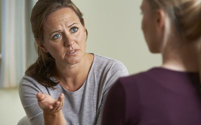 Mature woman talking to another woman