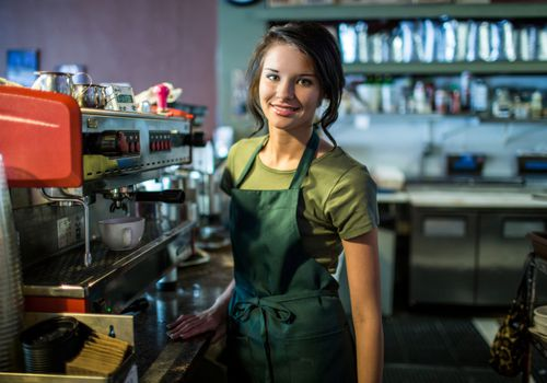 Teenage girl working as a barista in a cafe