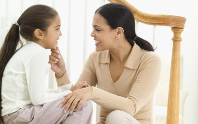 parent child communication - mother and daughter talking, smiling