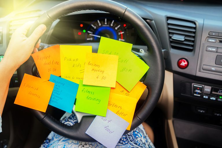 Post It notes on steering wheel