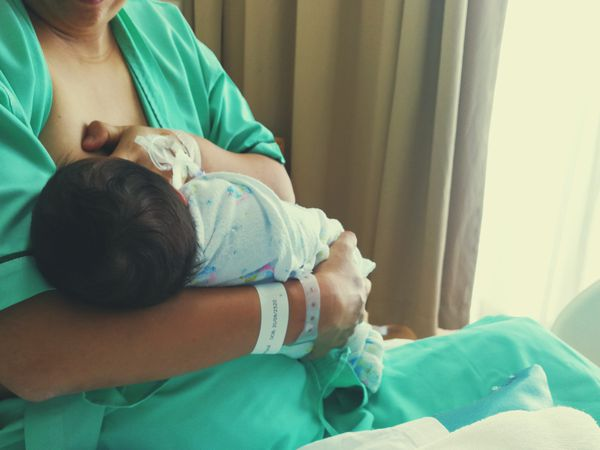 mother breastfeeding son
