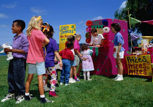 Children in a ticket line at a school carnival