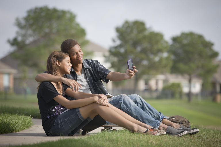 teenage couple taking a selfie