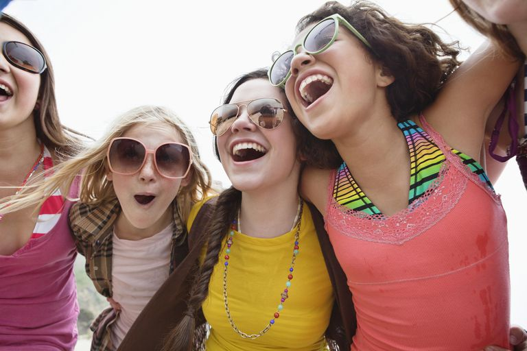 Portrait of a group of teenage girls laughing